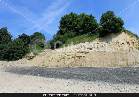 Old stone quarry stock photo, Scenic view of old stone quarry in countryside. by Martin Crowdy