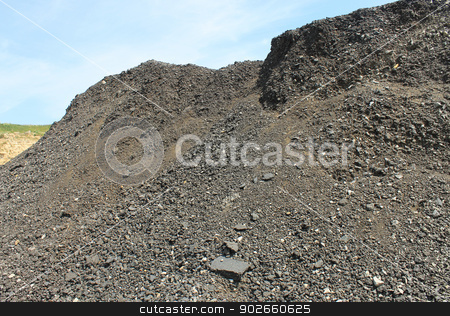 Pile of coal in quarry stock photo, Scenic view of pile of coal in quarry. by Martin Crowdy