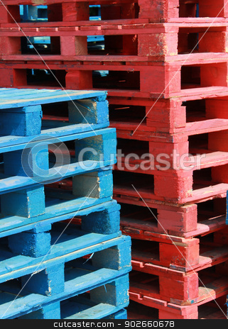 Wooden pallets stock photo, Closeup of red and blue wooden pallets. by Martin Crowdy