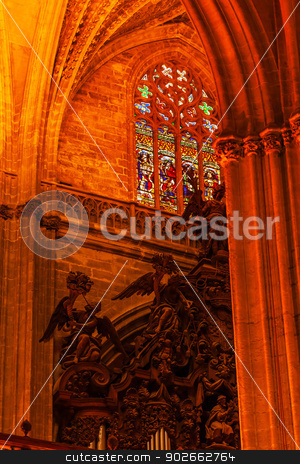 Arch Stained Glass Statues Cathedral of Saint Mary of the See Va stock photo, Arch Stained Glass Statues Seville Cathedral, Cathedral of Saint Mary of the See, Seville, Andalusia Spain.  Built in the 1500s.  Largest Gothic Cathedral in the World and Third Largest Church in the World.  Burial Place of Christopher Columbus. by William Perry