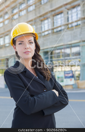 Portrait of Female Contractor Wearing Hard Hat at Construction S stock photo, Portrait of Young Attractive Professional Female Contractor Wearing Hard Hat at Construction Site. by Andy Dean
