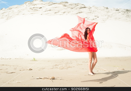 Attractive naked girl on sand stock photo, Portrait of a beautiful naked woman standing at sand background by Aikon