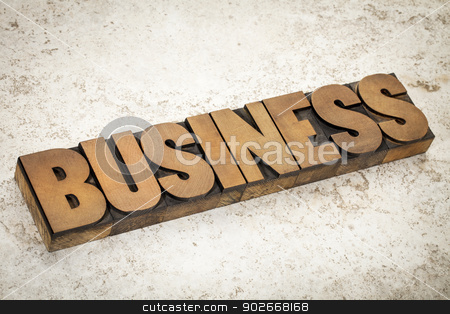 business word in wood type stock photo, business word in vintage letterpress wood type on a ceramic tile background by Marek Uliasz