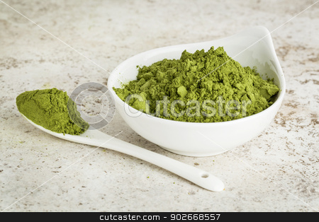 moringa leaf powder stock photo, moringa leaf powder in a small bowl with a spoon against a ceramic tile background by Marek Uliasz