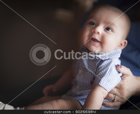 Cute Mixed Race Infant with Parents stock photo, Cute Mixed Race Infant Having Fun with His Parents. by Andy Dean