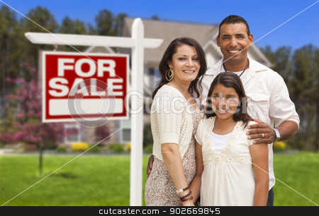 Hispanic Family in Front of Their New Home and Sign stock photo, Hispanic Mother, Father and Daughter in Front of Their New Home with Sold Home For Sale Real Estate Sign. by Andy Dean