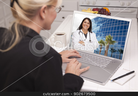 Woman In Kitchen Using Laptop - Online with Nurse or Doctor stock photo, Over Shoulder of Woman In Kitchen Using Laptop - Online Chat with Nurse or Doctor on Screen. by Andy Dean