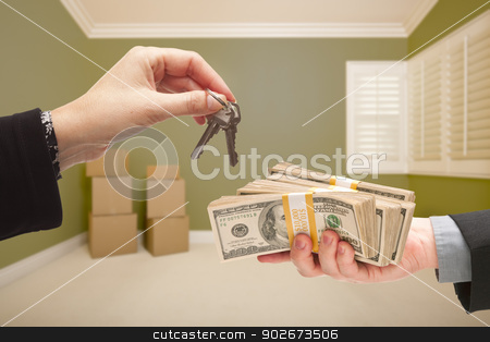 Woman Handing Over Cash For House Keys stock photo, Man and Woman Handing Over Cash For House Keys Inside Empty Green Room with Boxes. by Andy Dean