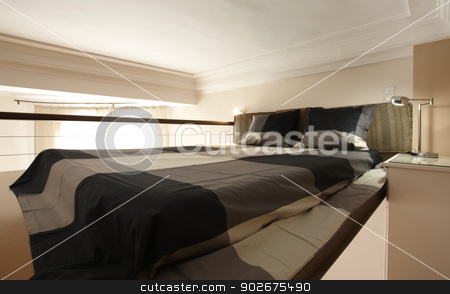 modern bedroom stock photo, A modern bedroom in an overhead attic by ABBPhoto
