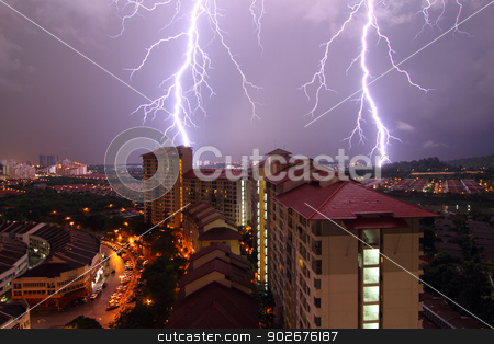 Lightning strikes stock photo, Two lightning bolts strike an urban skyline in Malaysia at night by Adrin Shamsudin