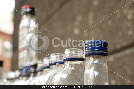 Alcohol problem stock photo, Empty bottles reflecting alcohol problems at the street by 1000 Words Images
