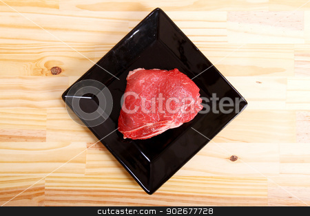 Meat stock photo, Some raw meat on a Plate. by Michael Osterrieder