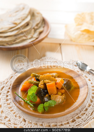 Vegetable curry dhal stock photo, Vegetable curry dhal, chapatti roti or Flat bread and papadom. Indian food on dining table. by szefei
