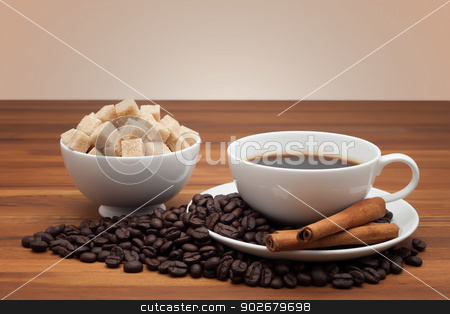 Coffee cup and saucer on a wooden table stock photo, Coffee cup and saucer on a wooden table by phasinphoto