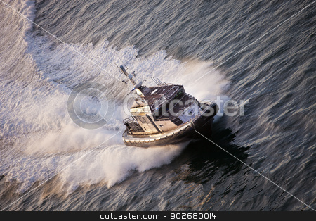 Police Boat on Patrol stock photo, Police Boat on patrol speeding through water by Scott Griessel