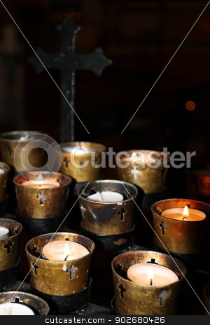 Church Candles stock photo, Candles in a church on black background. by Henrik Lehnerer