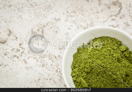 moringa leaf powder stock photo, moringa leaf powder in a small bowl against a ceramic tile background with a copy space by Marek Uliasz