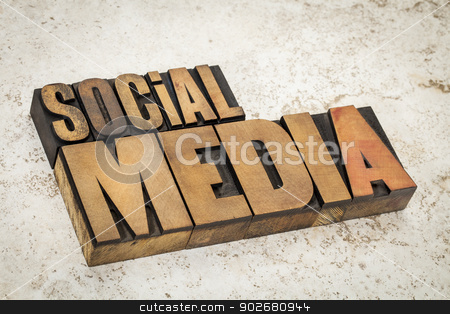 social media text in wood type stock photo, social media text in vintage letterpress wood type on a ceramic tile background by Marek Uliasz