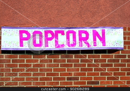 Popcorn banner. stock photo, Popcorn banner displayed on a wall outside. by OSCAR Williams