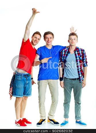 Young grimacing boy stock photo, Three young happy teenagers grimacing. Isolated on white background. by macsim