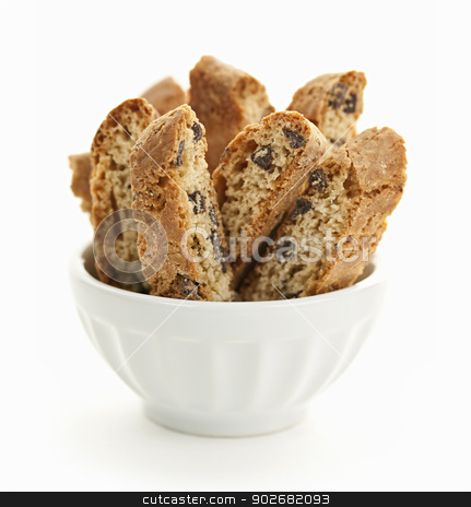 Biscotti cookies in bowl stock photo, Italian chocolate chip biscotti in bowl isolated on white background by Elena Elisseeva