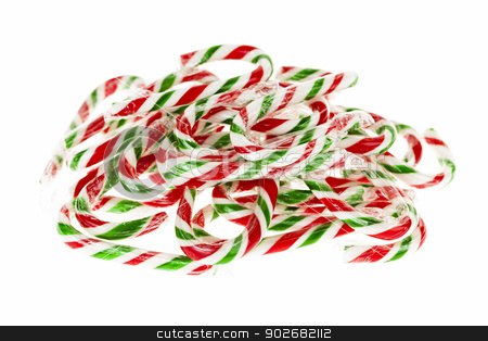 Candy canes stock photo, Pile of red and green Christmas candy canes isolated on white background by Elena Elisseeva