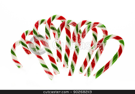 Candy canes stock photo, Christmas candy canes isolated on white background by Elena Elisseeva