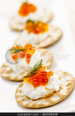Caviar appetizers stock photo, Closeup of caviar and cream cheese appetizer on crackers by Elena Elisseeva