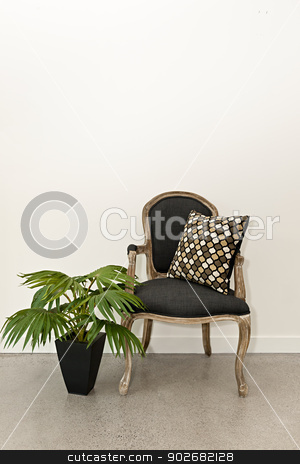 Antique armchair and plant near wall stock photo, Antique armchair furniture with houseplant against white wall by Elena Elisseeva