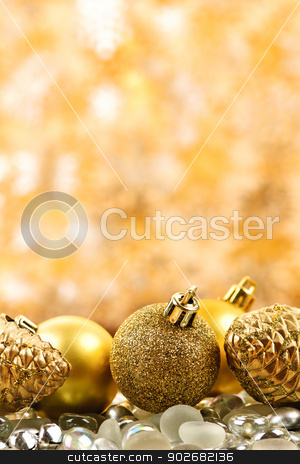 Christmas background stock photo, Golden Christmas background with ornaments and pine cones by Elena Elisseeva