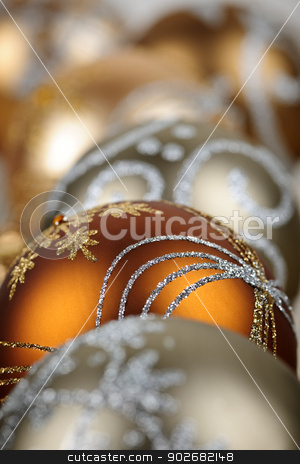 Gold Christmas ornaments closeup stock photo, Closeup of golden Christmas balls with festive designs by Elena Elisseeva