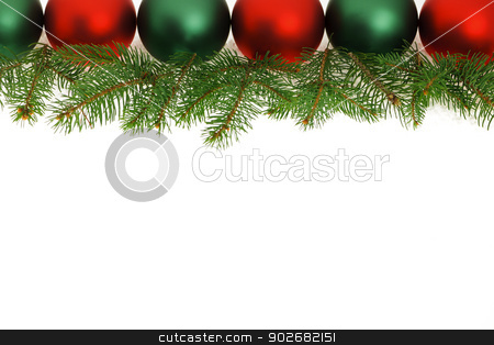 Border of green and red Christmas balls stock photo, Row of green and red Christmas ornaments with tree branches by Elena Elisseeva