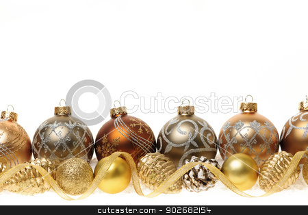 Golden Christmas ornaments border stock photo, Golden Christmas decorations with gold balls and ornaments on white background by Elena Elisseeva