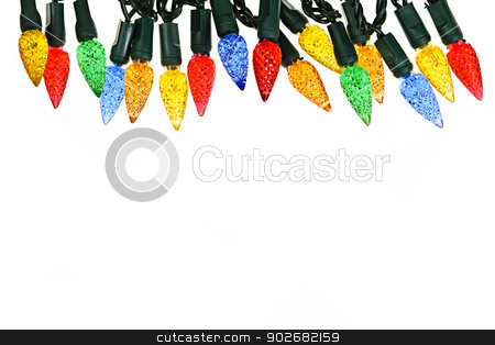 Christmas lights border stock photo, Multicolored string of Christmas lights isolated on white background by Elena Elisseeva