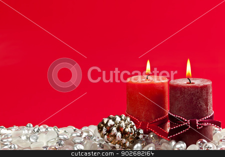 Red Christmas background with candles stock photo, Christmas candles and decorations on red background by Elena Elisseeva