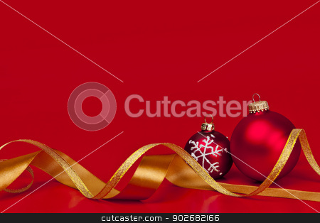 Red Christmas background with ornaments stock photo, Red Christmas background with ornaments and gold ribbon by Elena Elisseeva