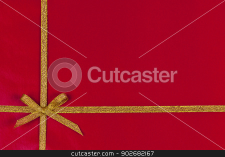 Red gift background with gold ribbon stock photo, Red background of present wrapped with gold ribbon and bow by Elena Elisseeva