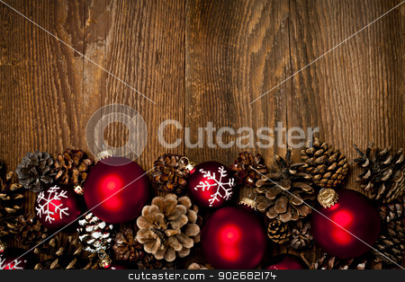 Wood background with Christmas ornaments stock photo, Rustic wood background with Christmas ornaments and pine cones by Elena Elisseeva