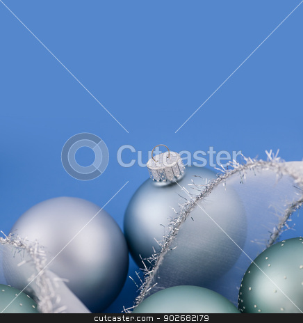 Christmas baubles on blue stock photo, Glass Christmas balls with holiday ribbon on blue background by Elena Elisseeva