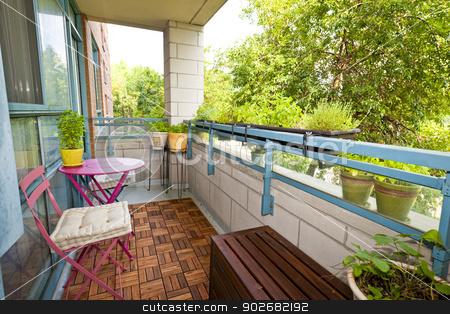 Apartment balcony stock photo, Balcony of condo with patio furniture and plants by Elena Elisseeva