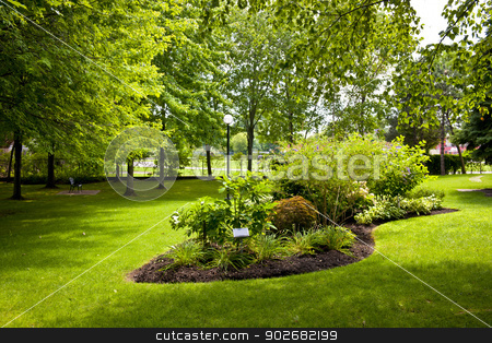 Garden in park stock photo, Lush landscaped grounds with garden in city park by Elena Elisseeva