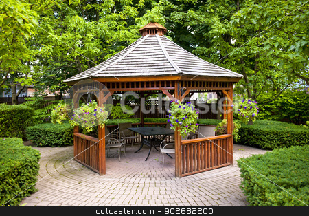 Gazebo in garden stock photo, Gazebo in landscaped garden with interlocking stone patio by Elena Elisseeva