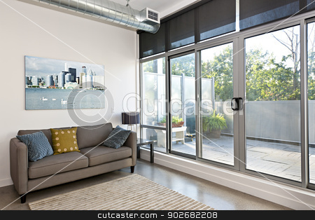 Modern living room and balcony stock photo, Living room with sliding glass door to balcony - artwork from photographer portfolio by Elena Elisseeva