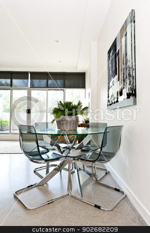 Modern condo dining room stock photo, Dining table and chairs in loft apartment - artwork from photographer portfolio by Elena Elisseeva