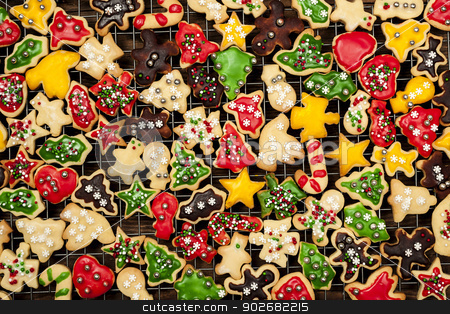 Homemade Christmas cookies stock photo, Cooling rack with freshly baked homemade shortbread Christmas cookies over wooden background from above by Elena Elisseeva