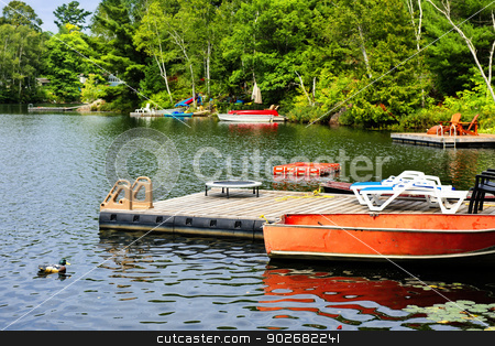 Cottage lake with diving platform and docks stock photo, Beautiful lake with docks and diving platform in Ontario Canada cottage country by Elena Elisseeva