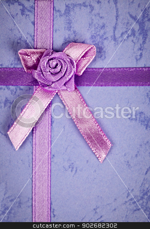 Gift ribbon on box stock photo, Pink gift ribbon and bow on present by Elena Elisseeva