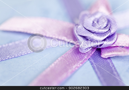 Gift ribbon on box stock photo, Closeup of pink gift ribbon and bow on present by Elena Elisseeva