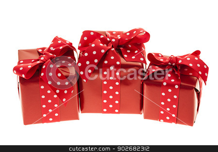 Red gift boxes stock photo, Three presents wrapped in red paper with polkadot ribbon by Elena Elisseeva