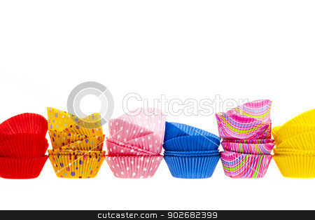 Muffin or cupcake baking cups stock photo, Several stacks of colorful muffin or cupcake cups isolated on white background as border by Elena Elisseeva